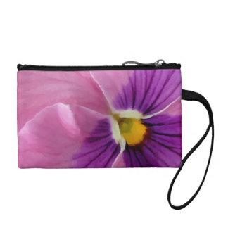 ピンクの紫色のパンジーの花のマクロ コインパース