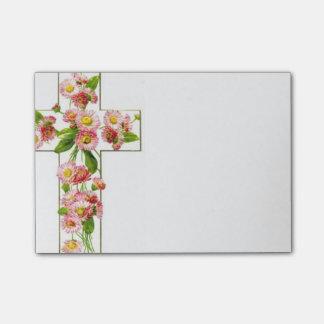 ピンクの花が付いている白い十字 ポストイット