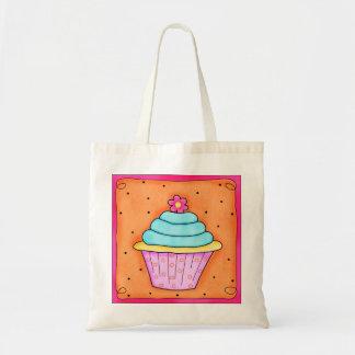 ピンクの花の風変わりなカップケーキのトートバック トートバッグ