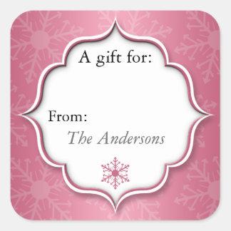 ピンクの雪片のクリスマスのプレゼントのラベルのステッカー スクエアシール