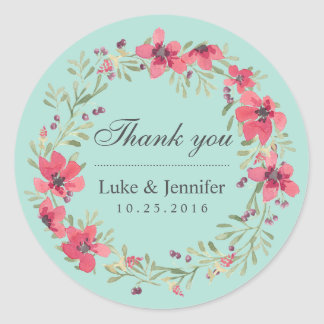 ピンクの青い水彩画の花のリースの結婚式のステッカー ラウンドシール