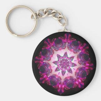 ピンクまたは紫色の明るいネオンスターバストの万華鏡のように千変万化するパターン キーホルダー