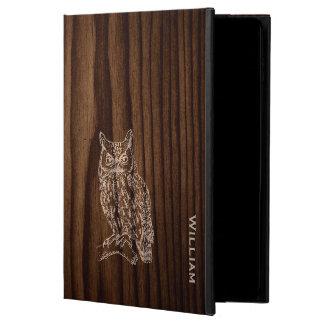 フクロウのiPadの空気2箱との暗い木製の穀物の一見
