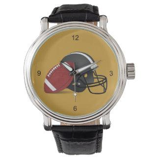 フットボールおよびヘルメットの金時計 腕時計
