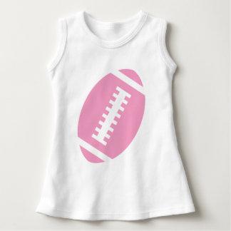 フットボールのベビーの白|の前部ピンクのフットボールのグラフィック ドレス