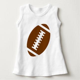 フットボールのベビーの白|の前部フットボールのグラフィック ドレス