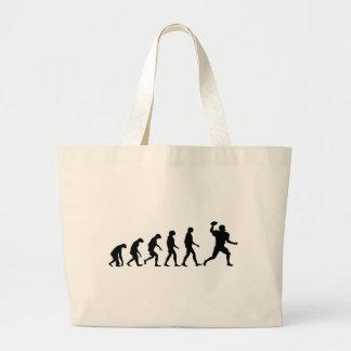フットボールの進化 ラージトートバッグ