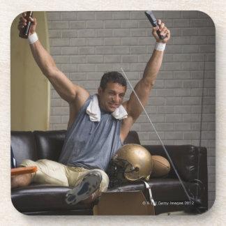 フットボール選手の監視にフットボールおよび元気づけること コースター