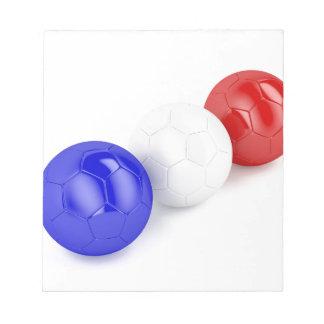 フランスの旗が付いているフットボールの球 ノートパッド