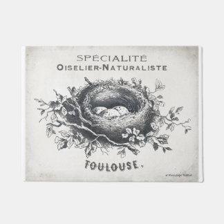 フランス語が付いている玄関マットはフランスのな執筆の鳥の巣を採取しましたり及び卵を投げつけます ドアマット