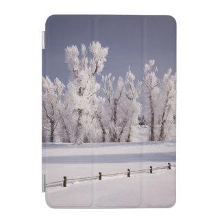 フロストは木および塀、コロラド州を覆いました iPad MINIカバー