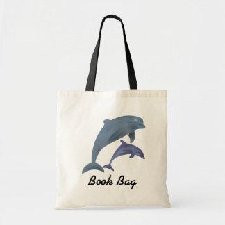 ブックバッグを跳んでいる熱帯イルカ トートバッグ