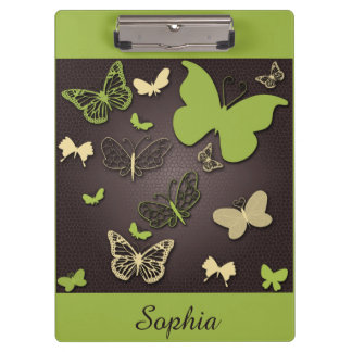 ブラウンのクリップボードの緑およびクリーム色の蝶 クリップボード
