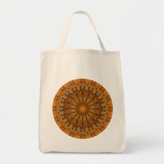 ブラウン、オレンジおよび金ゴールドの円形の曼荼羅 トートバッグ