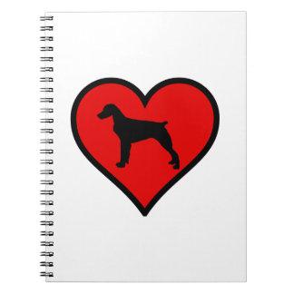 ブリッタニースパニエル犬のハート愛はシルエットの後をつけます ノートブック