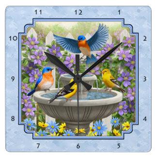 ブルーバードのGoldfinchesの花園の噴水の青 スクエア壁時計