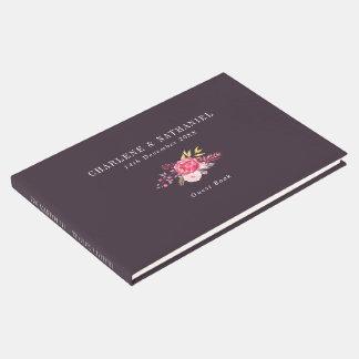 プラムおよび来客名簿を結婚するピンクの植物の花 ゲストブック