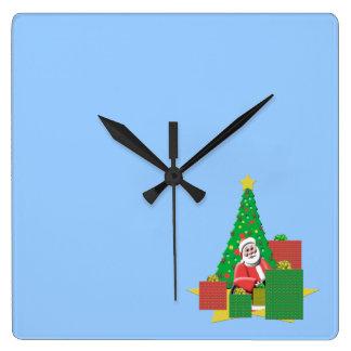 プレゼントの青いクリスマスの柱時計が付いているサンタ スクエア壁時計