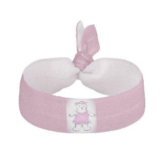 ヘアタイのピンクの服のアートワークのシロクマ ヘアタイ
