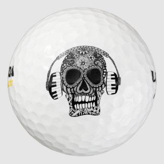 ヘッドホーンのゴルフ・ボールが付いているもつれさせたスカル ゴルフボール