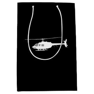 ヘリコプターのチョッパーのシルエットの飛行黒 ミディアムペーパーバッグ