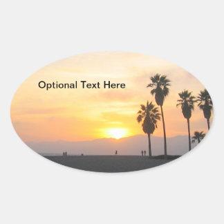 ベニスのビーチカリフォルニアの日没 楕円形シール
