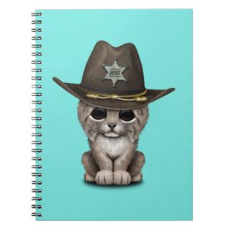 ベビーのオオヤマネコのカブスのかわいい保安官 ノートブック