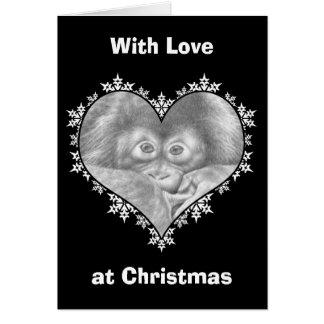 ベビーのオランウータンの雪片のハートのクリスマスカード グリーティングカード