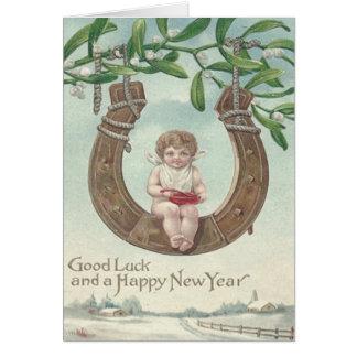 ベビーの新年の蹄鉄の振動ヤドリギ カード