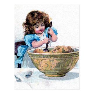 ベーキングのヴィンテージの女の子のベーキングのケーキのイラストレーション ポストカード
