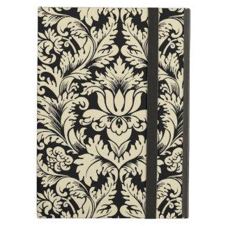 ベージュおよび黒いヴィンテージの花柄のダマスク織