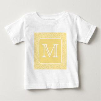 ベージュ黄色いヒョウのプリント。 カスタムなモノグラム ベビーTシャツ