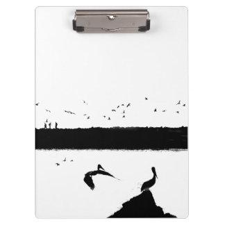ペリカンの鳥の野性生物動物のビーチ クリップボード