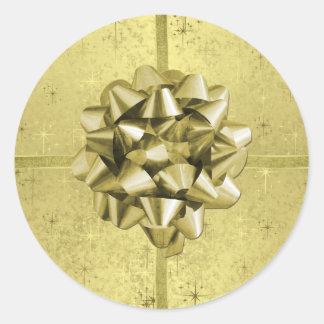 ホイルの金クリスマスの星、リボン及び弓 ラウンドシール