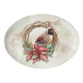 ポインセチアを持つ冬の(鳥)ショウジョウコウカンチョウ 磁器大皿
