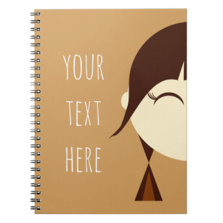 ポニーテールのノートを持つ小さな女の子 スパイラルノート