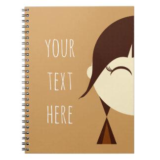 ポニーテールのノートを持つ小さな女の子 ノートブック