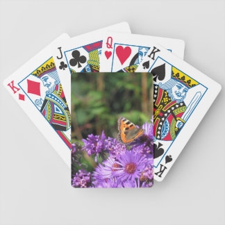 マダラチョウおよび紫色の花 バイスクルトランプ