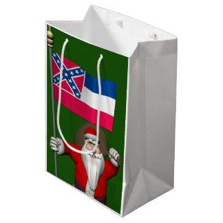 ミシシッピーの旗を持つサンタクロース ミディアムペーパーバッグ