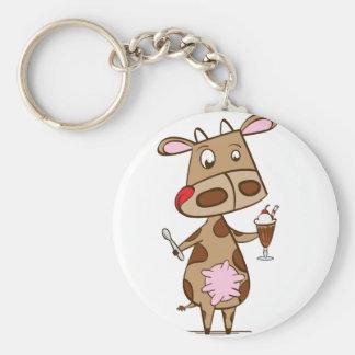 ミルクセーキを楽しんでいる牛 キーホルダー