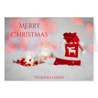 メリークリスマスのトナカイのセーターのバッグカード カード