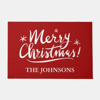 メリークリスマスの名前入りな一流の赤い休日 ドアマット