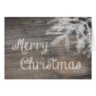 メリークリスマスの常緑樹およびPinecones カード