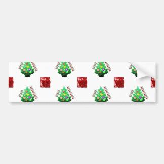 メリークリスマスの木およびギフト バンパーステッカー