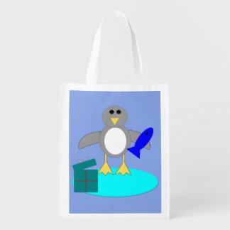 メリークリスマスの魚釣りのペンギンのエコバッグ エコバッグ