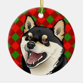 メリークリスマスの黒およびタンの柴犬のオーナメント セラミックオーナメント