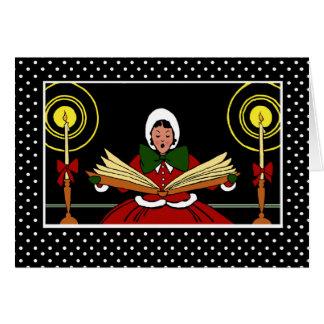 メリークリスマス、キャロルの歌を歌っている陽気な女の子 カード
