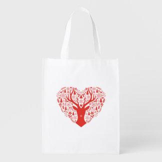 メリークリスマス、赤いハートを持つシカ エコバッグ
