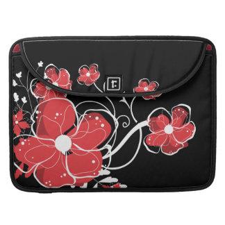 モダンでガーリーな赤と白の花 MacBook PROスリーブ