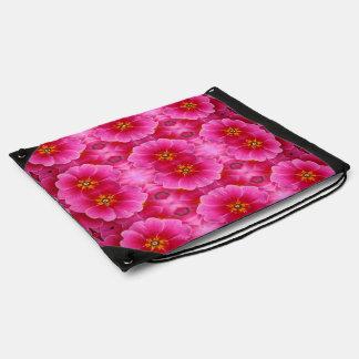 モダンで抽象的なピンクの黄色い蘭パターン ナップサック